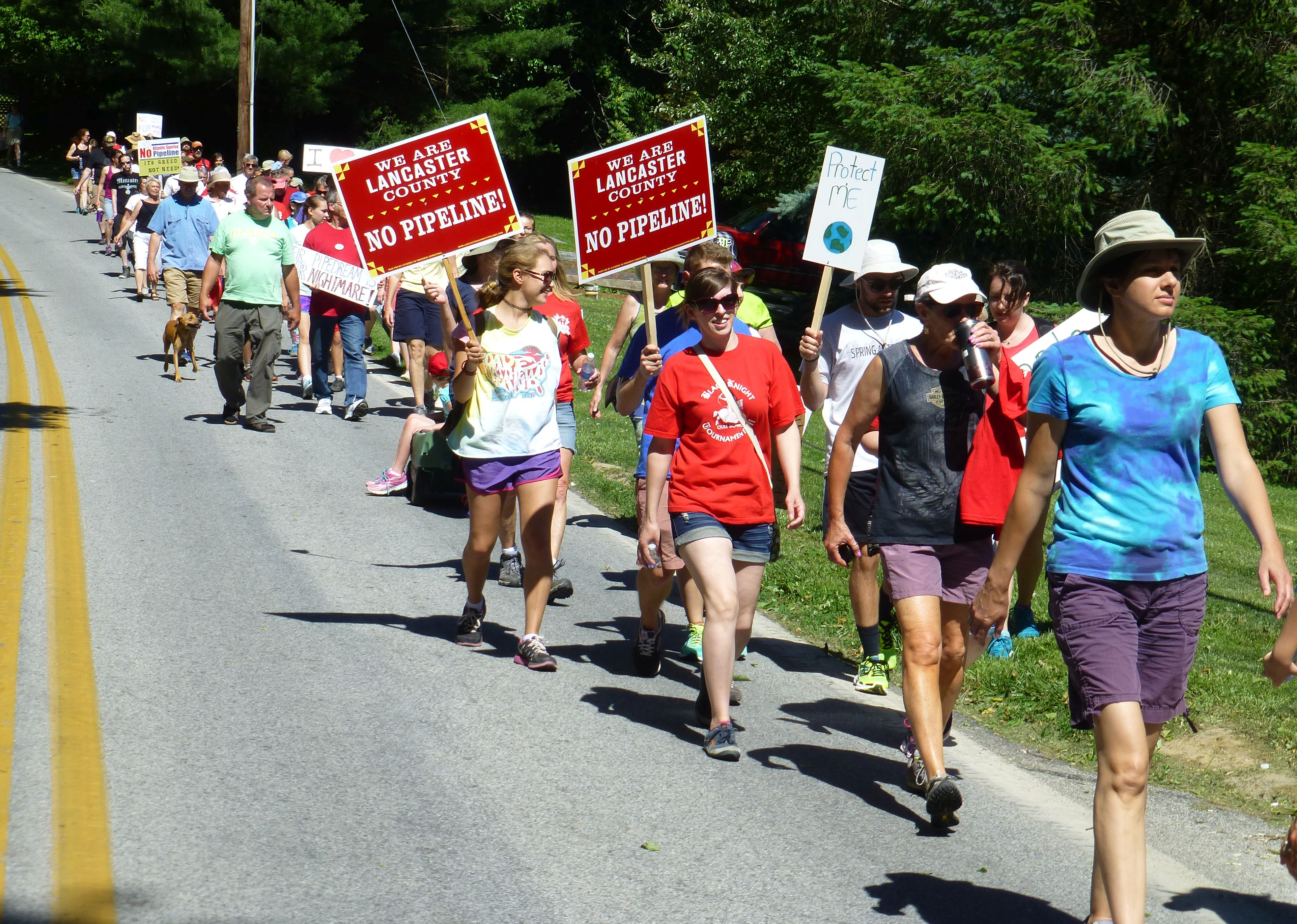 Protesters walk against proposed Atlantic Sunrise pipeline in Conestoga Township, Pa./ Photo by Mark Hand