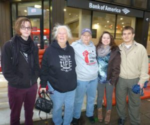 From left, Niki Carroll, Eula Dyson, Joan Biren, Bethany Flores, Joshua Pena protest Dakota Access Pipeline project at Washington, DC, branch of Bank of America./Photo by Mark Hand